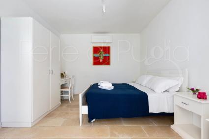 La camera da letto al piano terra della bella casa vacanze
