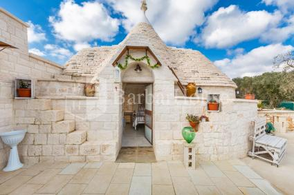 Double bedroom in trullo in B&B with swimming pool