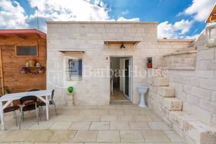 Camera tripla in b&b con piscina e solarium in Puglia